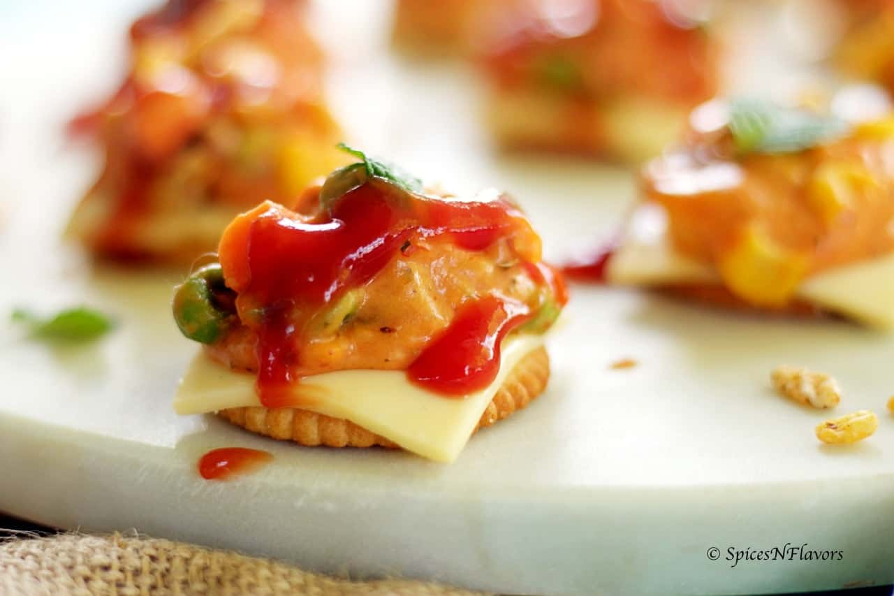 cheesy monaco bites monaco biscuit party topping starter recipe easy party starter recipe indian festival recipe party food potluck idea simple bachelor food
