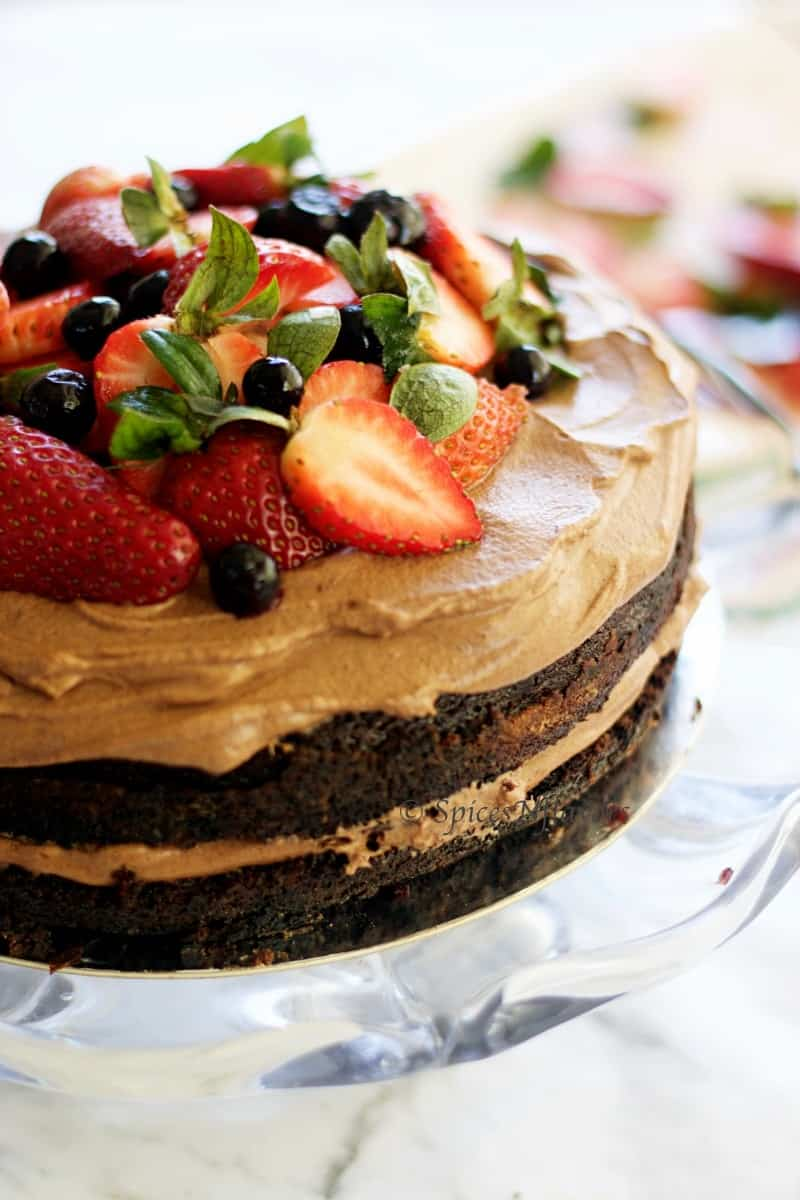 close up image of one bowl chocolate cake with berries