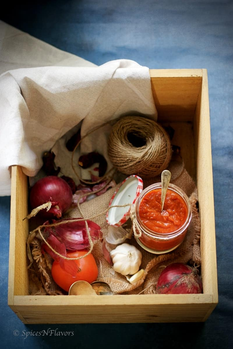 momos chutney jar kept in a box along with other ingredients like onion garlic
