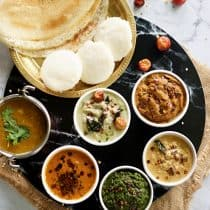 top complete view of dosa, idli, sambhar and 5 south indian chutney recipe
