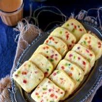 hyderabad karachi bakery biscuits, hyderabad karachi bakery biscuits recipe, tutti fruitti biscuits, fruit biscuits, indian biscuits, indian bakery biscuits recipe, indian cookies, eggless karachi biscuits, how to make karachi bakery style biscuits, how to make karachi biscuits, karachi biscuits recipe, eggless indian biscuits,