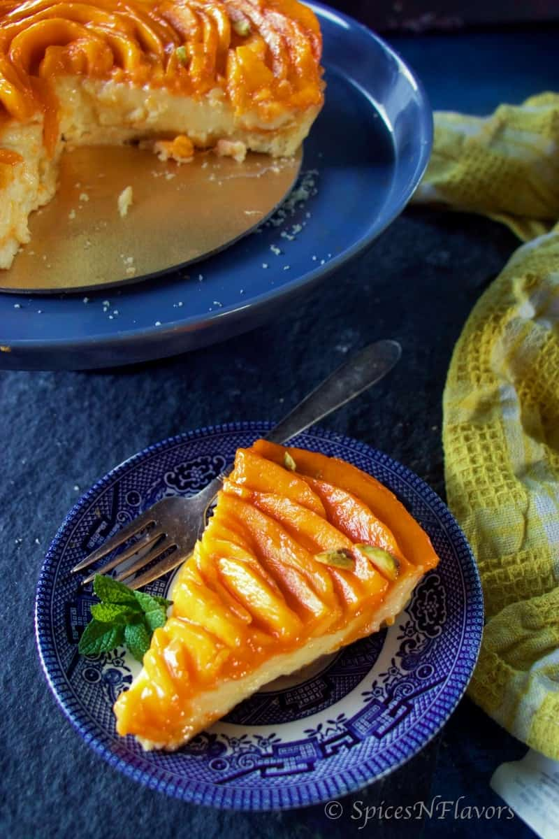 a sliced image of fresh fruit tart with mangoes