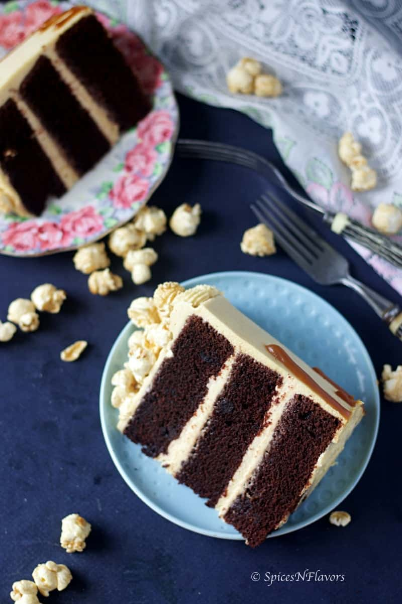 sliced image of eggless chocolate caramel cake showing three layers of cake 2 layers of caramel frosting