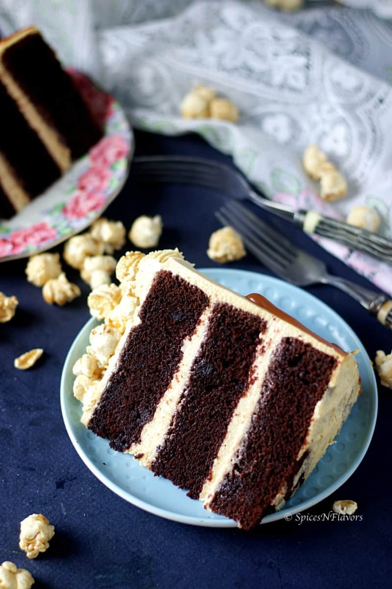 close up image of sliced eggless chocolate caramel cake showing triple layers of chocolate cake with creamy caramel frosting