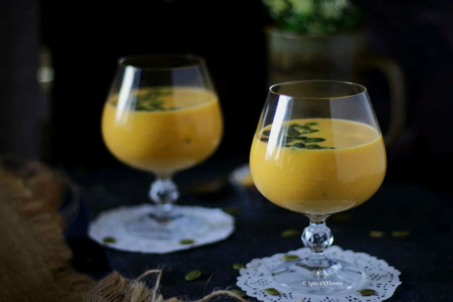 horizontal view of pumpkin custard or pumpkin kheer served in glasses