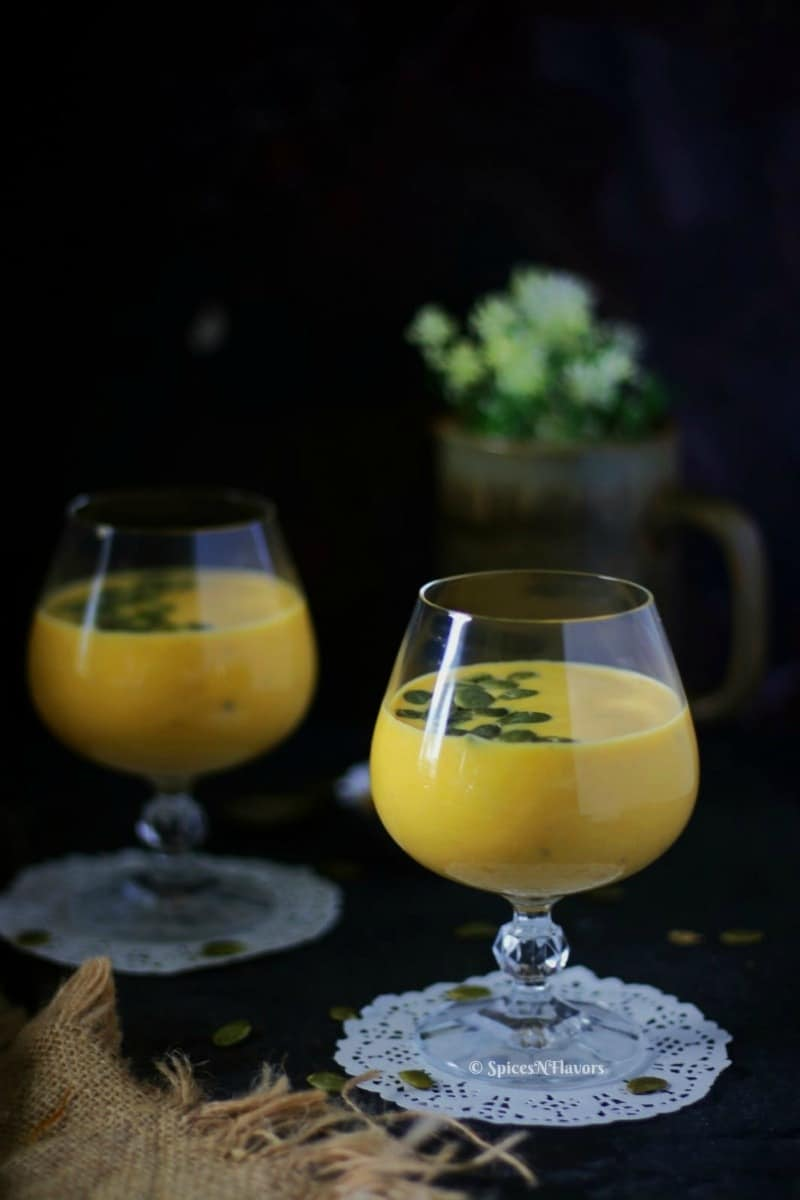 vertical image of pumpkin custard or kaddu ki kheer being served in glasses