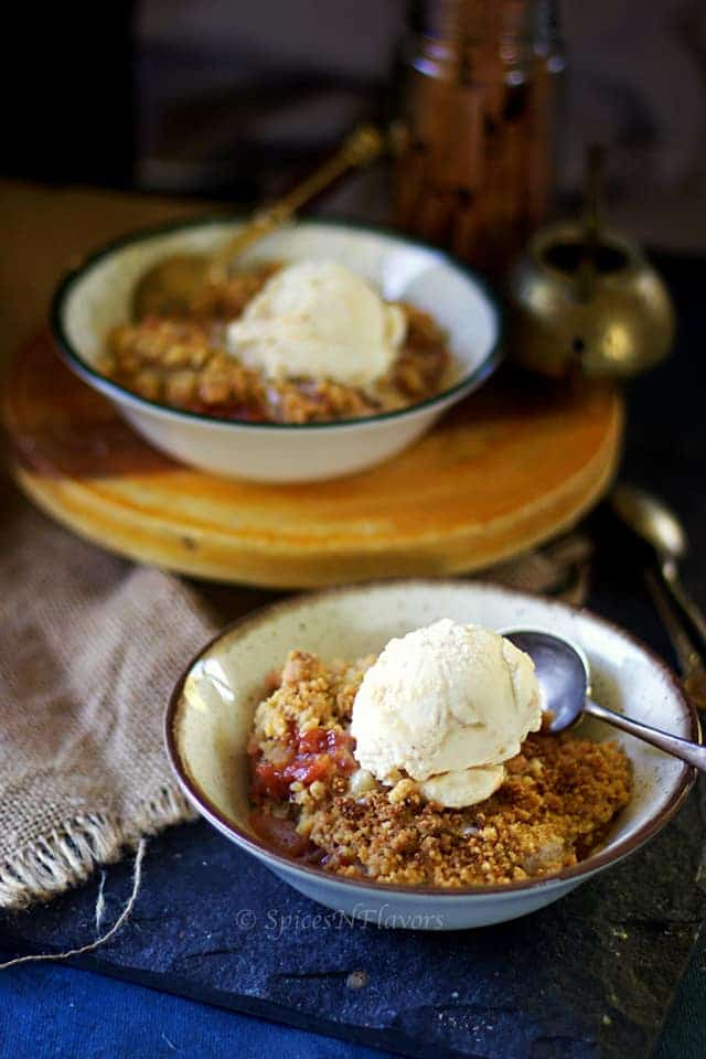 easy apple crisp served in a bowl with icecream