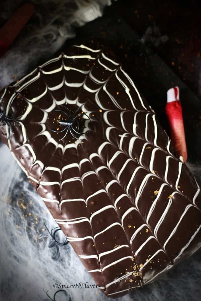 vertical image of easy halloween spider web cake