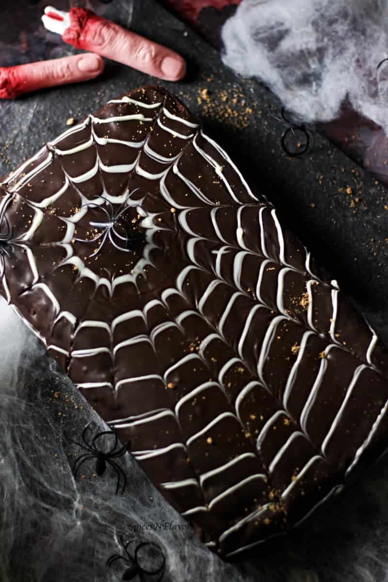 dark and moody image of halloween spider web cake design