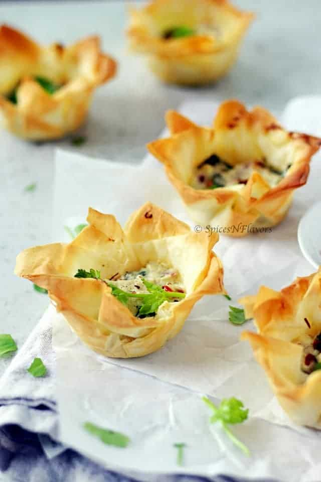 image of easy spanokopita or spinach and feta cups showing the crispy exterior of the cups