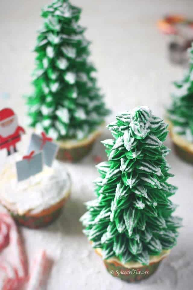 top view of christmas tree cupcakes frosted with snow on top