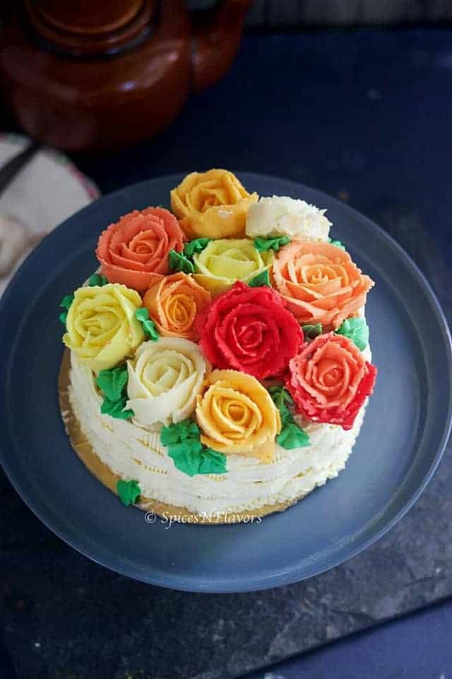 Basket weave cake adorned with buttercream roses made using best buttercream frosting
