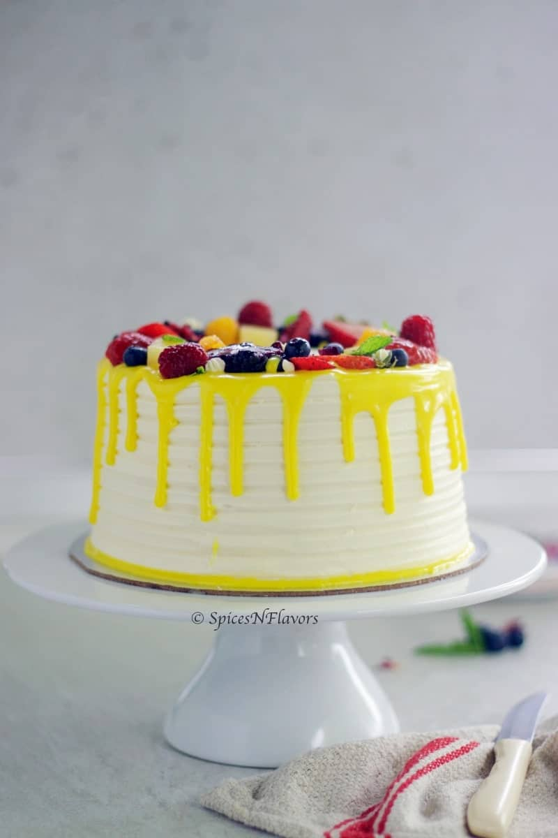 Fresh Fruit Cake placed on a cake stand