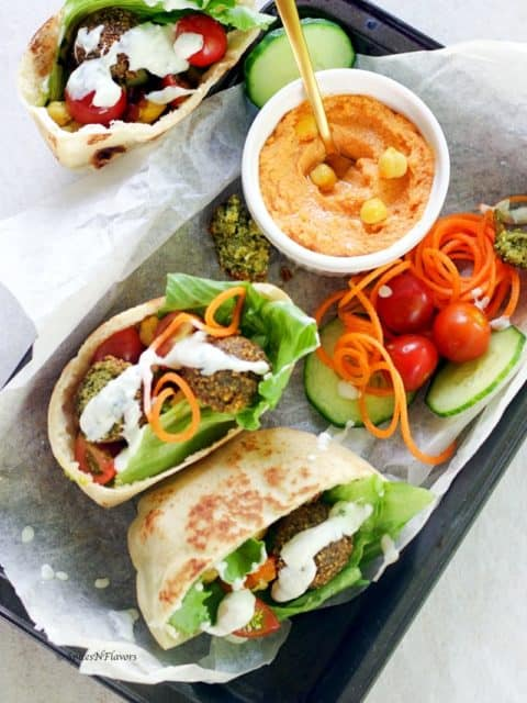 pita bread pockets stuffed with hummus, falafel, balela salad, greens and tzatziki sauce
