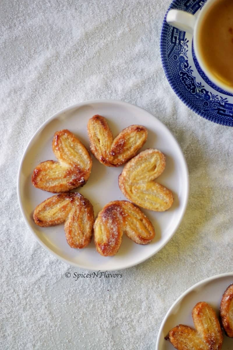 french Palmiers arranged like flowers on a white plate