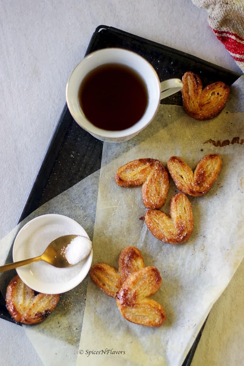 baked french palmiers served in the baking tray with black coffee