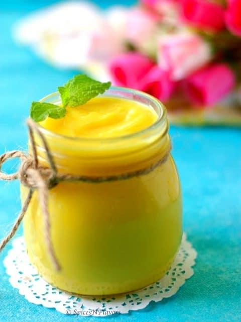 close up image of instant pot lemon curd with mint leaf garnish
