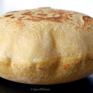 image showing puffed up instant pot whole wheat pita bread