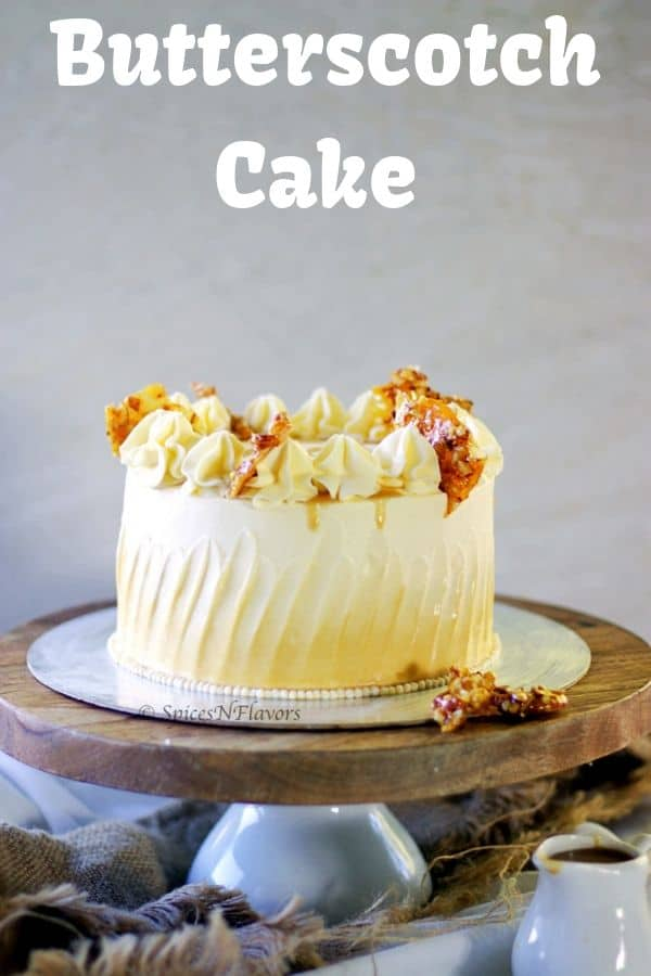 straight image of whole butterscotch cake placed on a cake board and stand