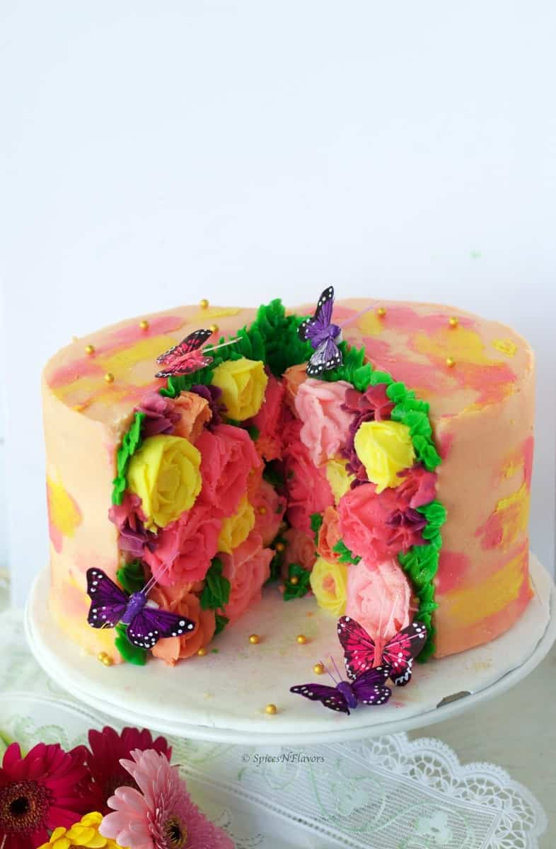 Buttercream flower cake decorated using the trending cut out cake