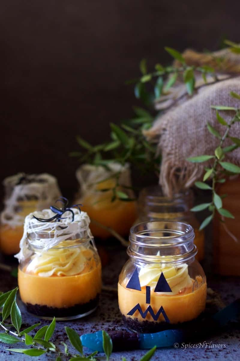 instant pot pumpkin cheesecake in jars decorated as spiderweb and monster jars for Halloween