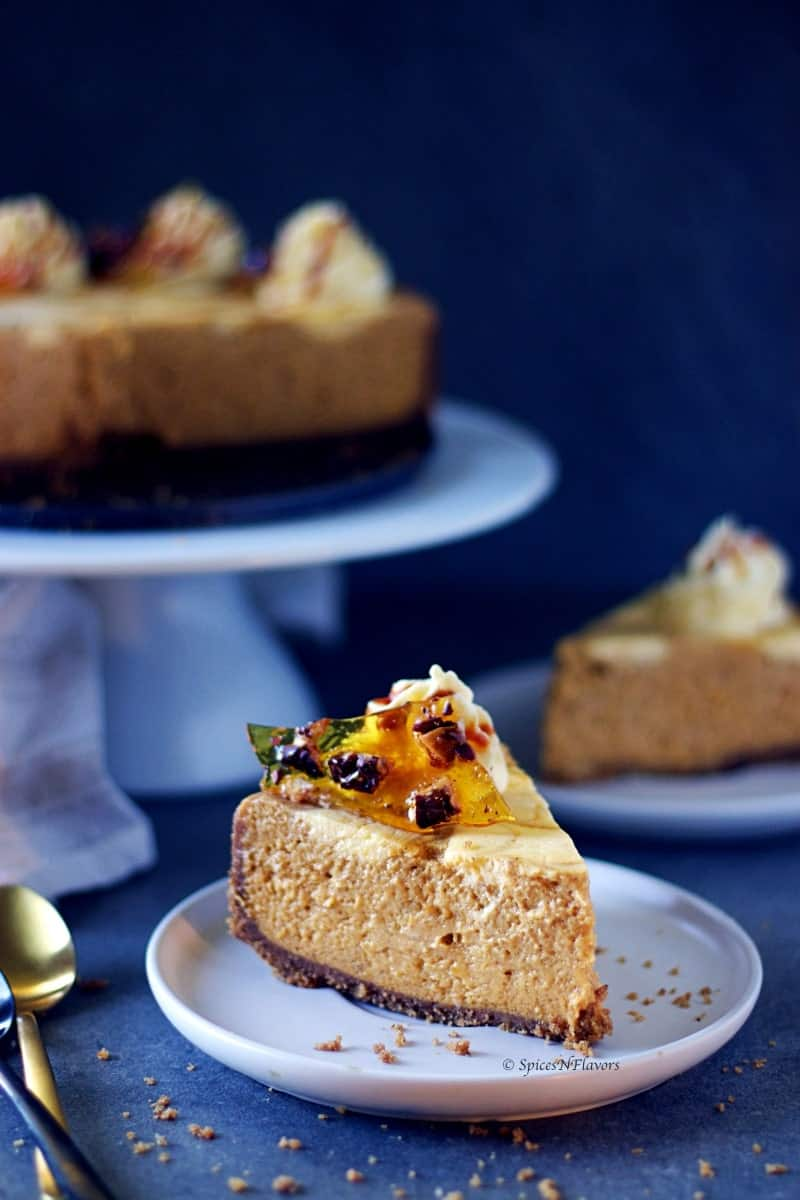 a slice of the best pumpkin cheesecake