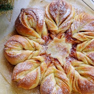 close up image of star bread with dusting of icing sugar