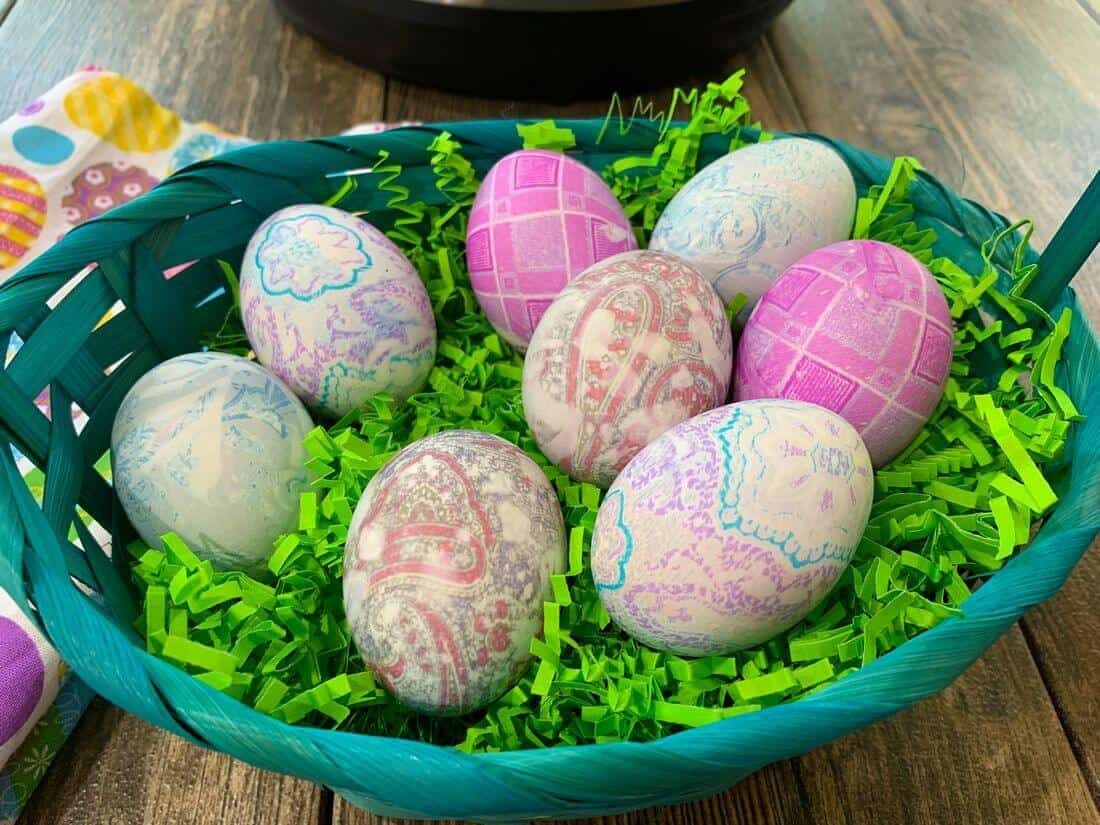 tie dyed easter eggs placed in a basket