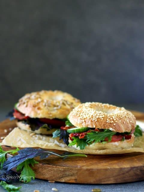 bagel sandwiches placed on a wooden serving board