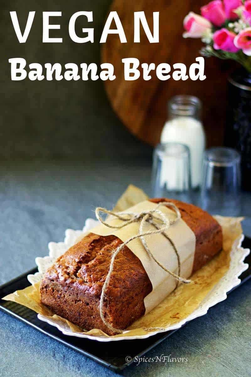 banana bread wrapped in a parchment paper and placed on a white tray