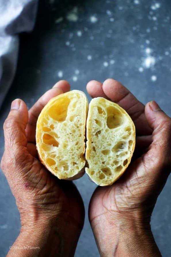 ciabatta bread with open crumbs held in between the palms