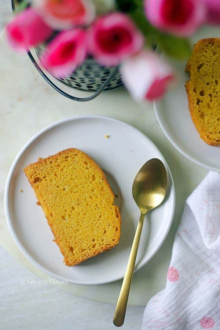 cake sliced placed on a white plate with a spoon