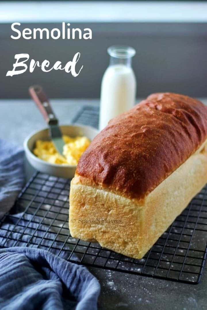 semolina bread placed on a wire rack with a bottle of milk and butter spread on the side