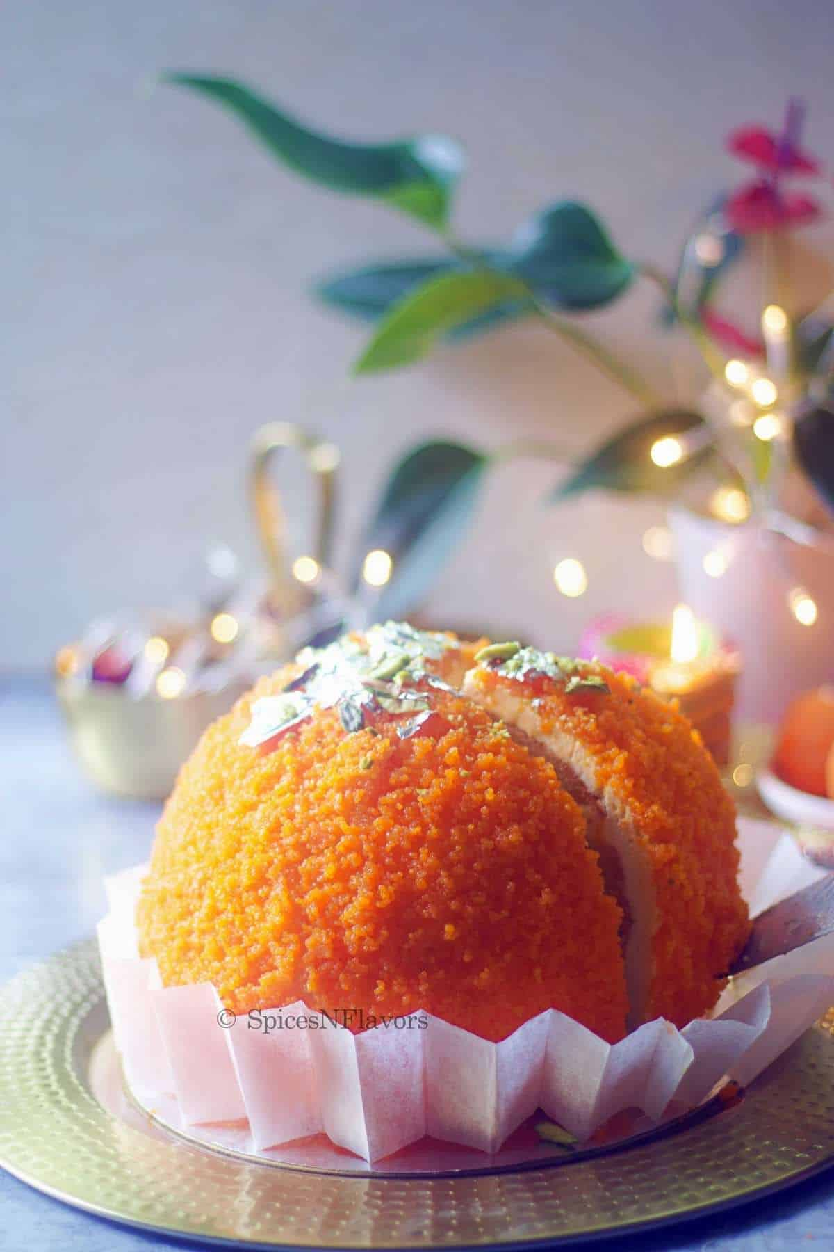 ladoo cake with a part of it sliced