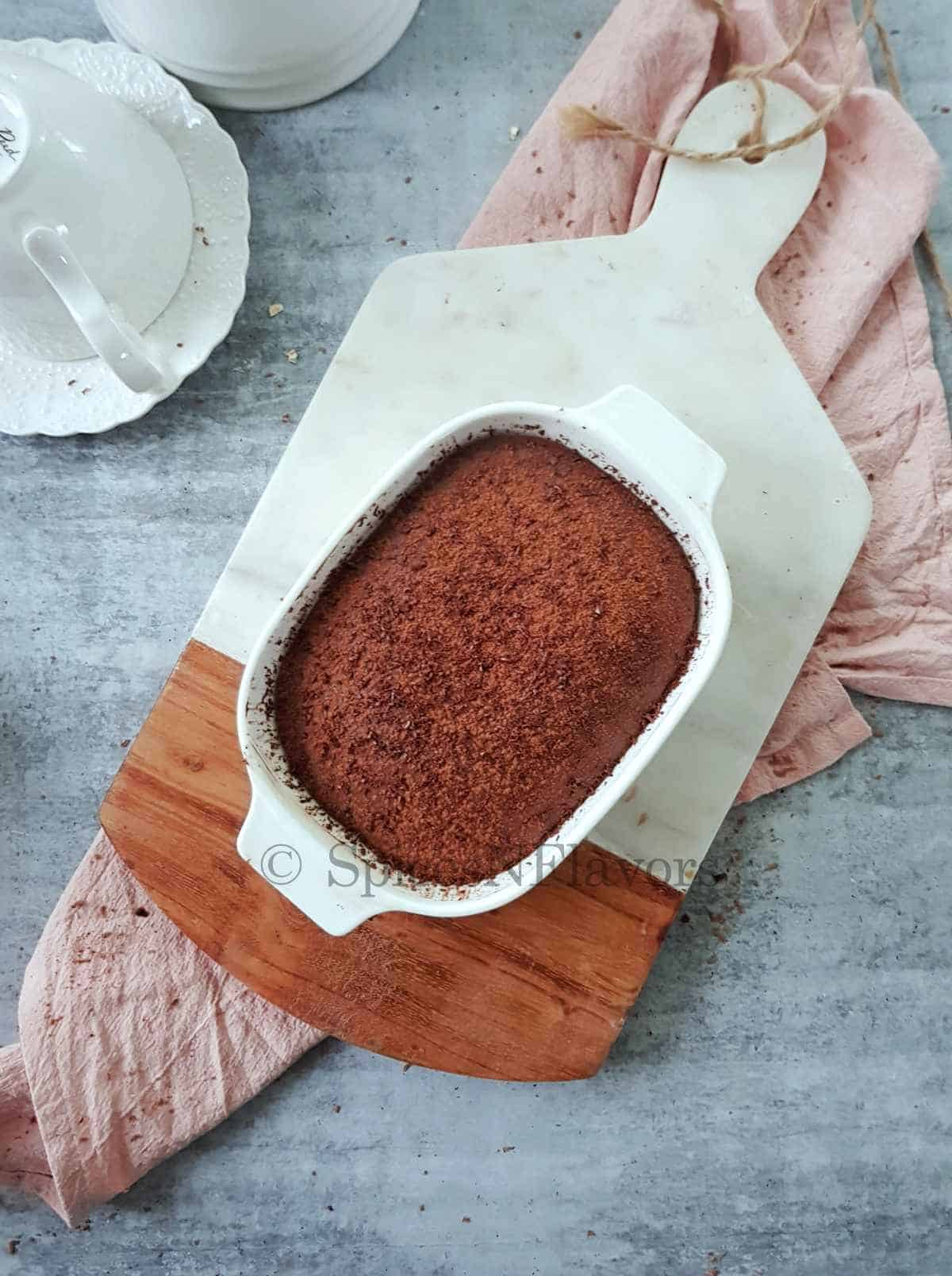 nutella baked oats placed on a white marble chopping board