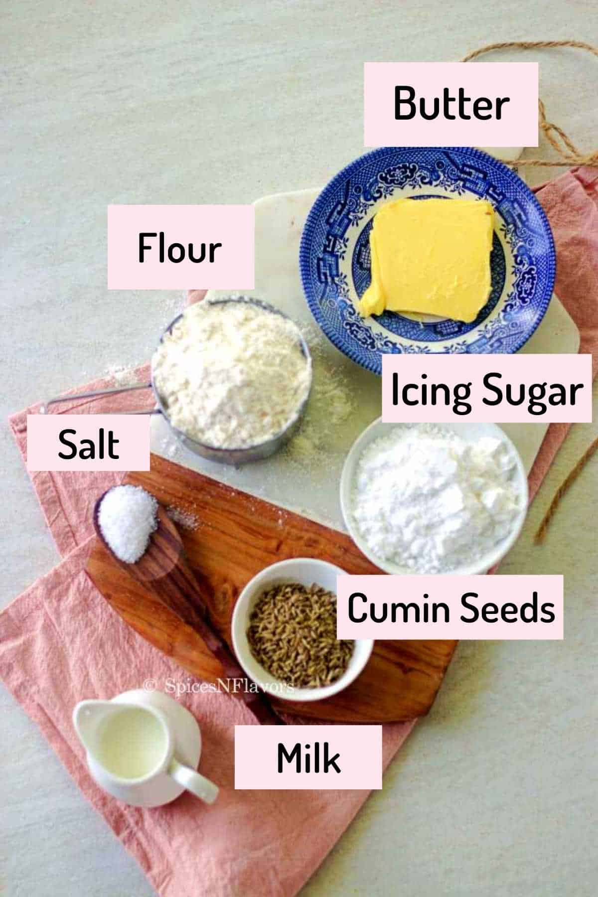 ingredients needed to make biscuits are placed on a marble cutting board