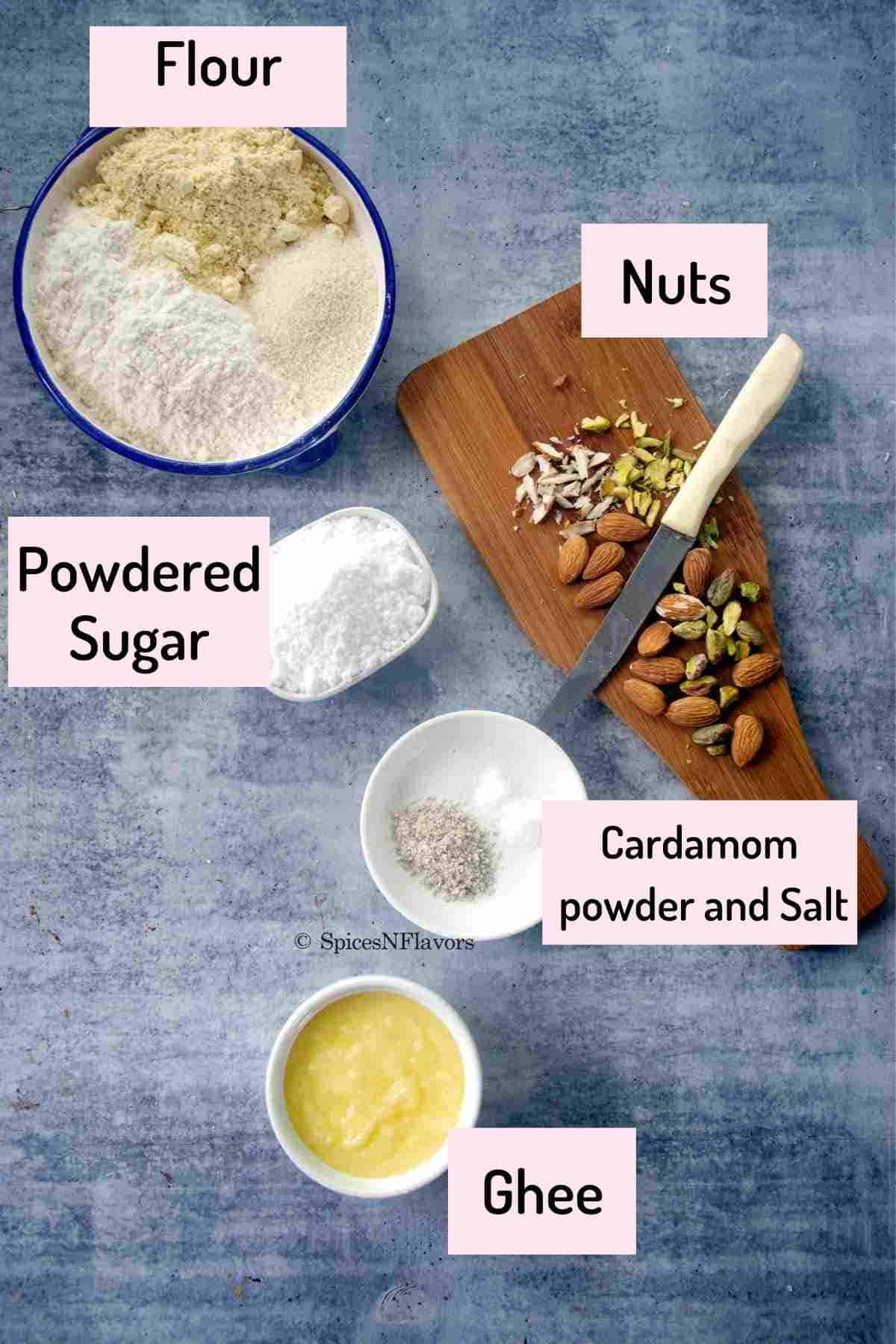 ingredients needed to make the biscuits are arranged in small bowls