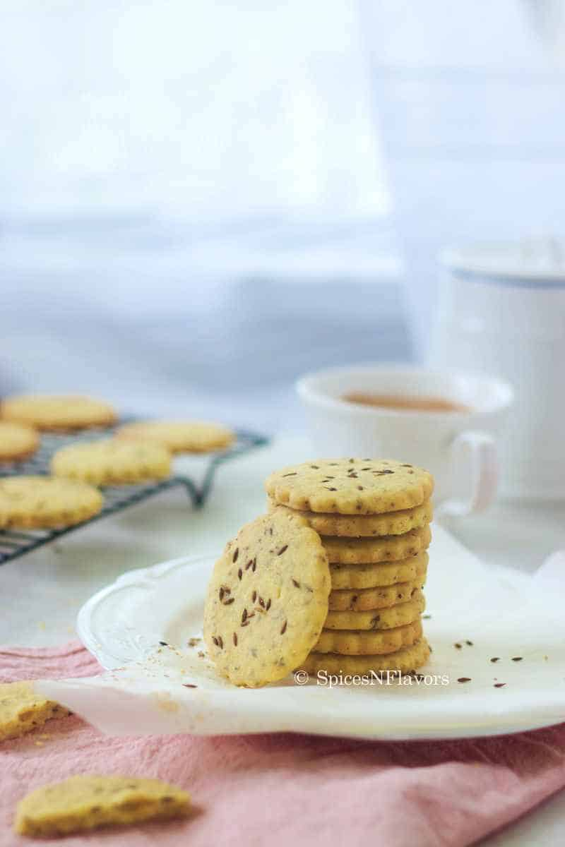biscuits stacked on each other and placed on a white plate