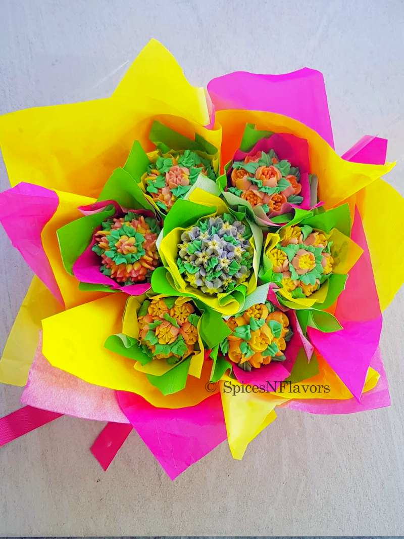 cupcakes arranged in a bouquet placed on a white background