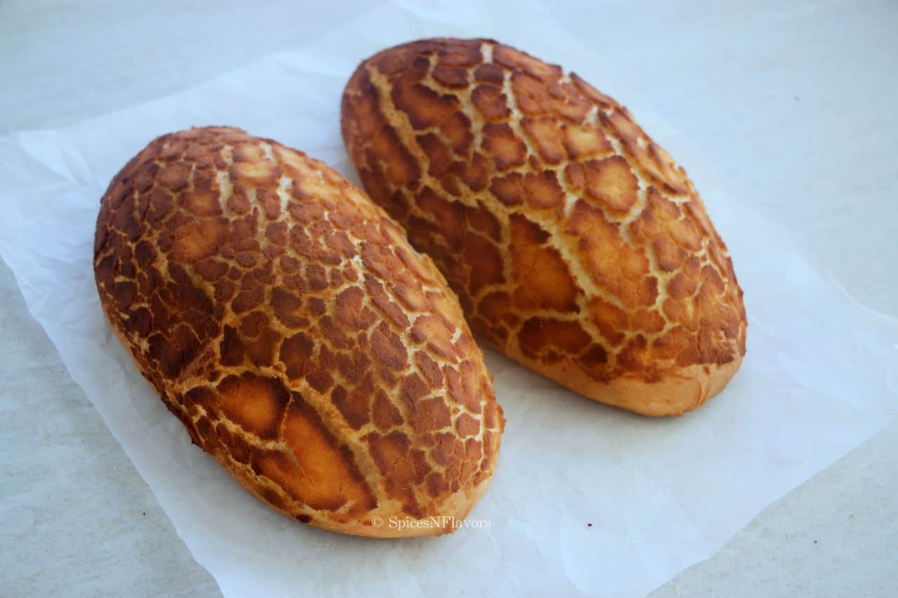 tiger bread rolls placed on a white parchment paper