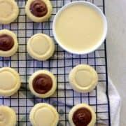 condensed milk cookies arranged on a wire rack