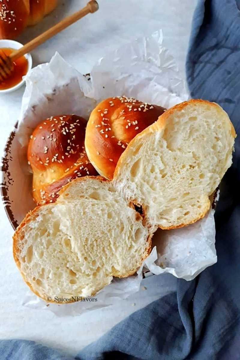 sliced challah rolls bread placed in a bowl