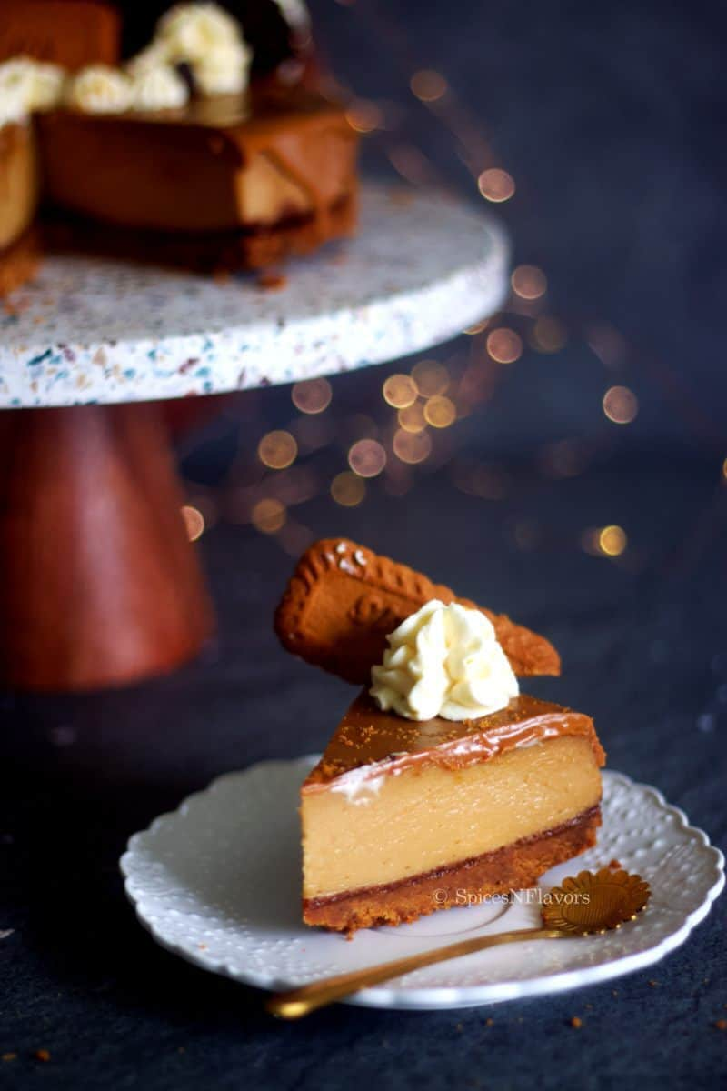 sliced image of biscoff cheesecake placed on a white plate