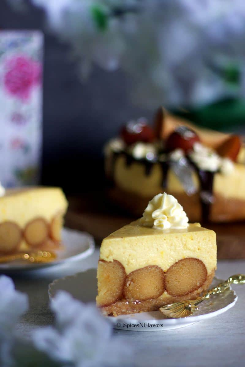 sliced image of gulab jamun cheesecake showing the interior texture of the cake