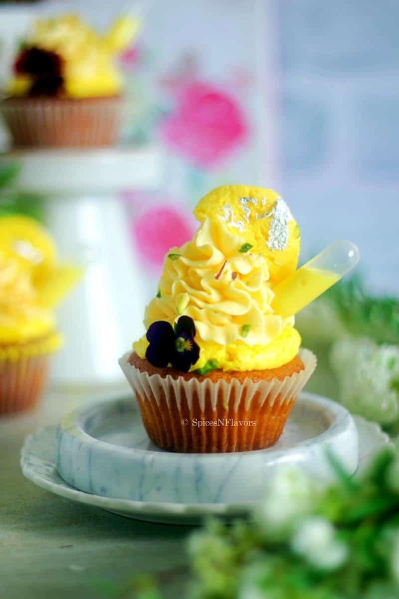 close up image of rasmalai cupcake placed on white marble coaster