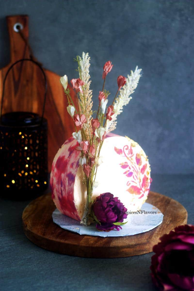 side angle of the cake showing the dried flower arrangement